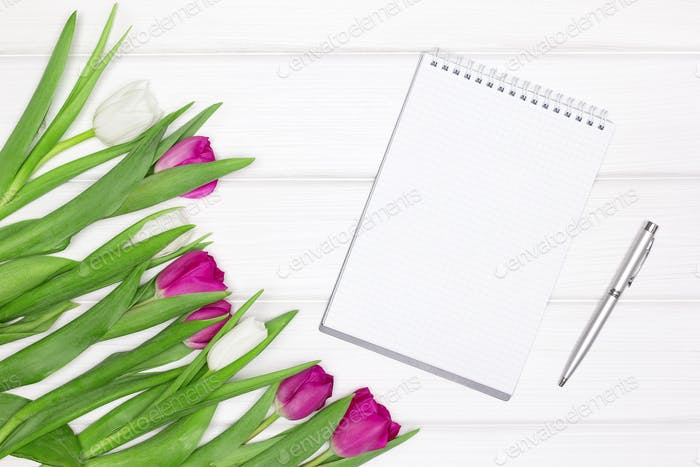 Open blank notebook, pen with tulip flowers. Abstract feminine concept