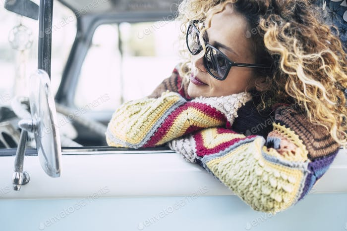 Beautiful portrait of pretty woman enjoy and dream outside the car