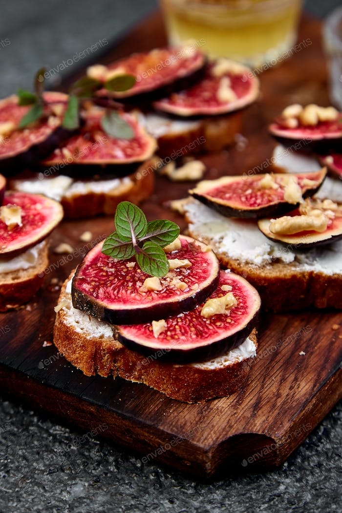 Bruschetta  or ctostini with cottage cheese, figs and honey.