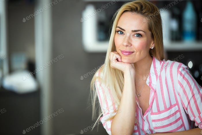 Portrait of a beautiful blonde woman smiling.