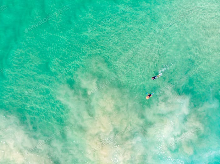 Surfers Out At Sea