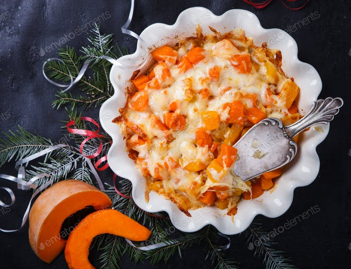 Casserole of pumpkin with onions and cheese.