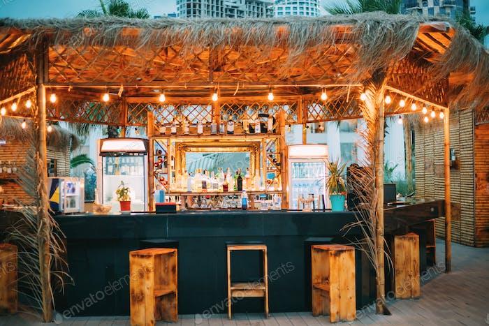 Evening Bar In Form Of Tropics On Sea Coast