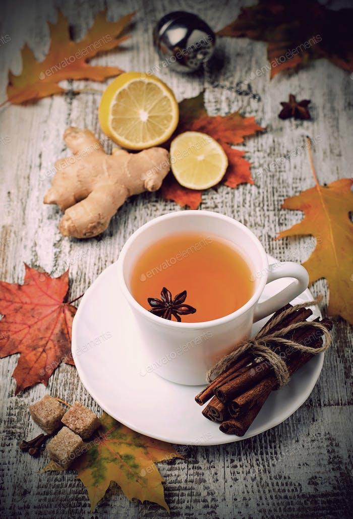 Ginger, lemon and cop of tea on light background