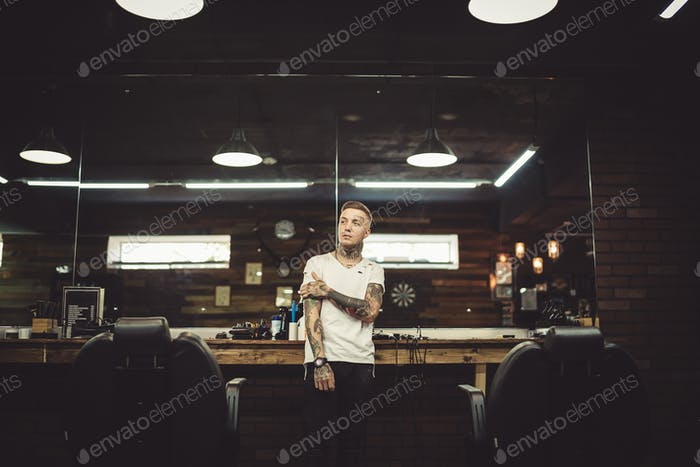 Portrait of tattooed barber