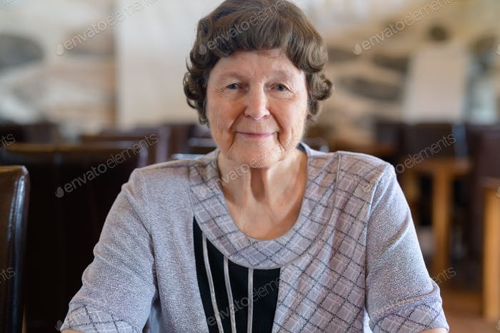 Beautiful Senior Woman Relaxing At The Coffee Shop