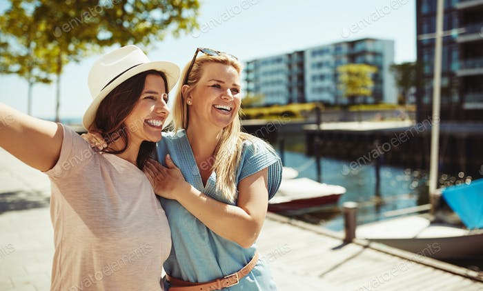 Two laughing friends enjoying a day together in the city