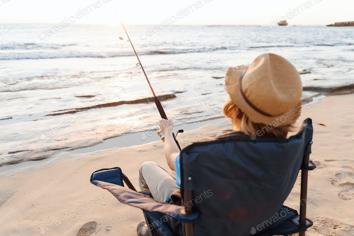 Teenage boy fishing at sea
