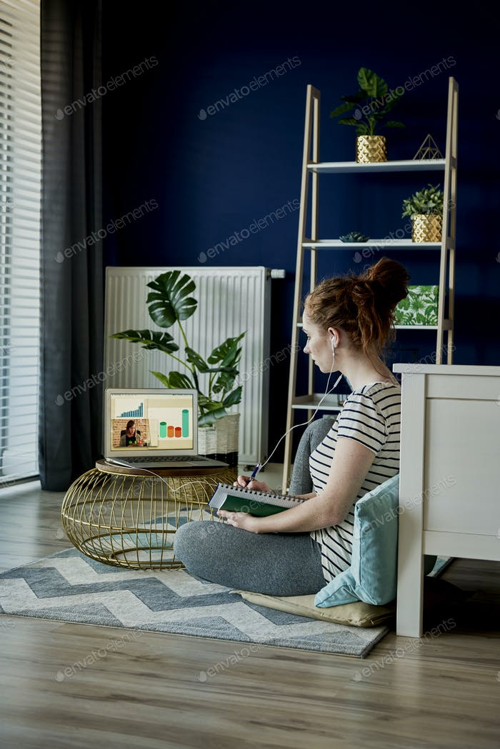 Vertical image of young woman at home office