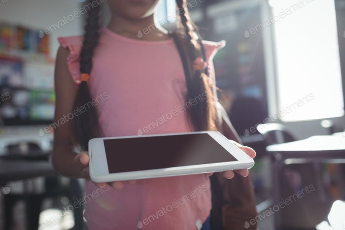 Midsection of girl using digital tablet