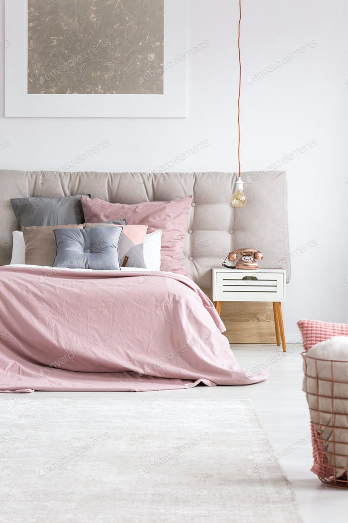 Elegant bedroom with copper phone
