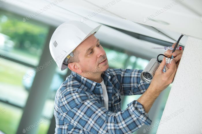 professional cctv technician working