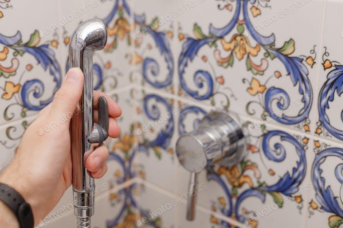 Man using bidet in toilet or bathroom. Male hygiene