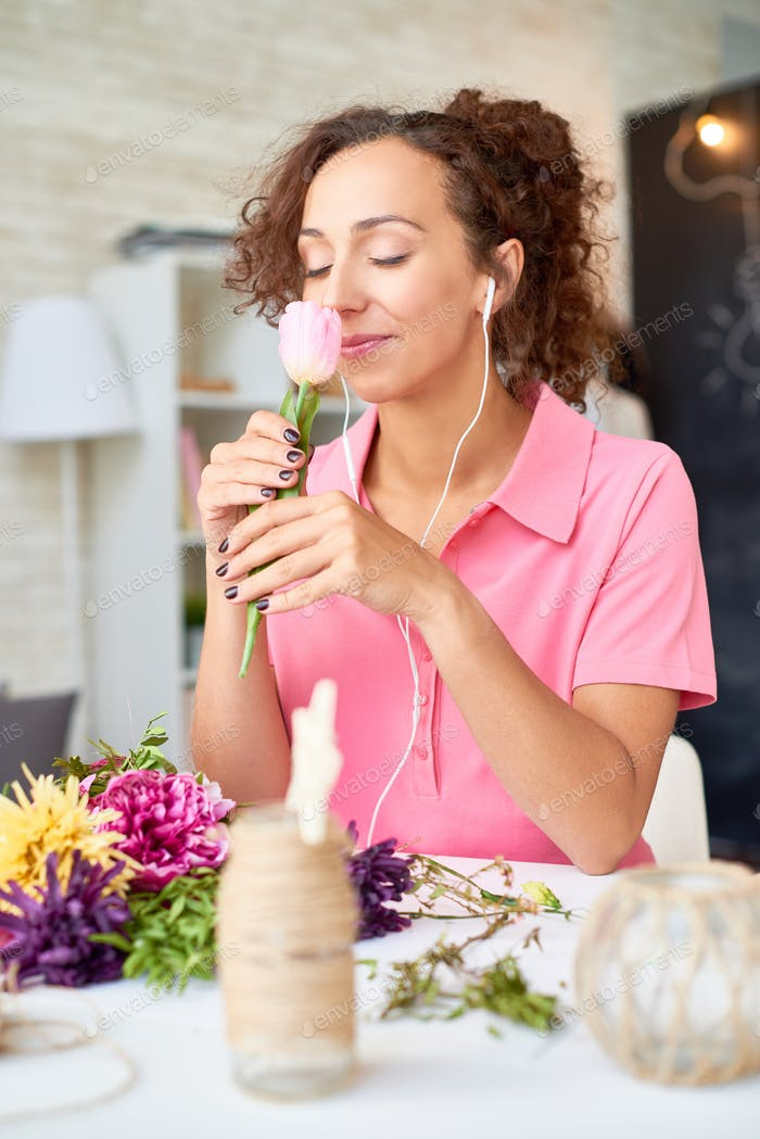 Happy Young Woman Arranging Flowers