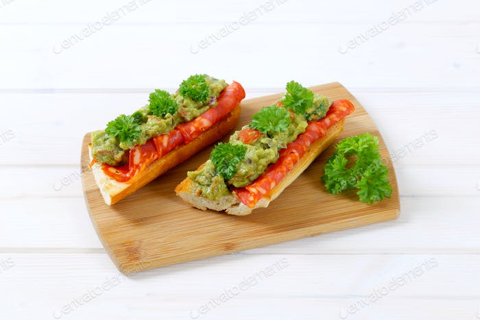 baguettes with salami and guacamole