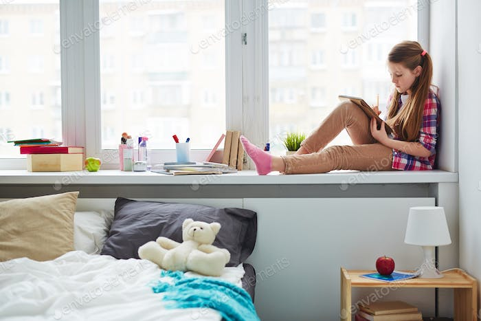 Girl with Notebook on Window sill