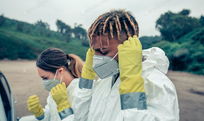 Young people putting on protective masks