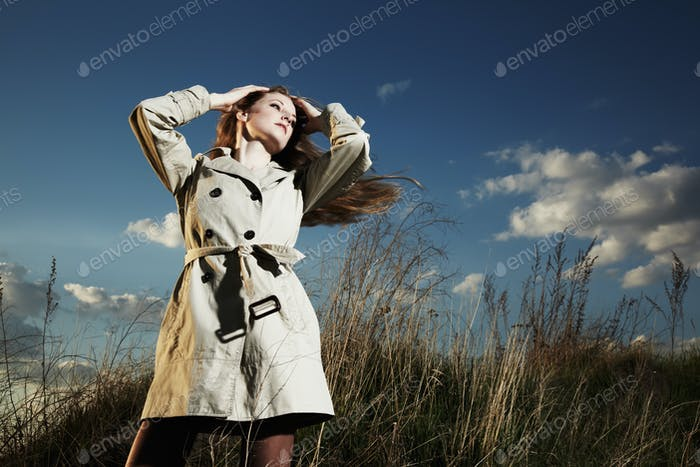 Fashion portrait of elegant woman in a raincoat