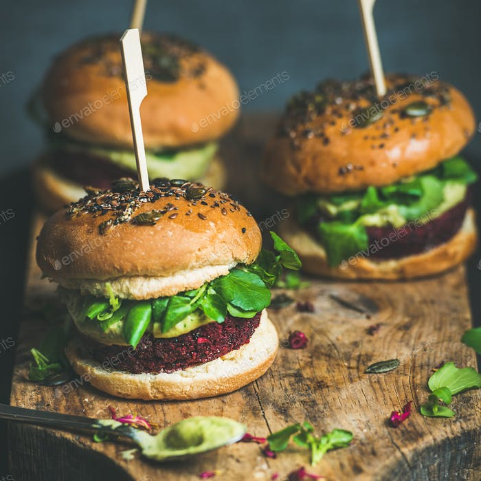 Healthy vegan burger with beetroot-quinoa patty and avocado sauce