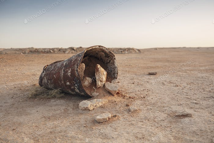 Rusted drum in the desert
