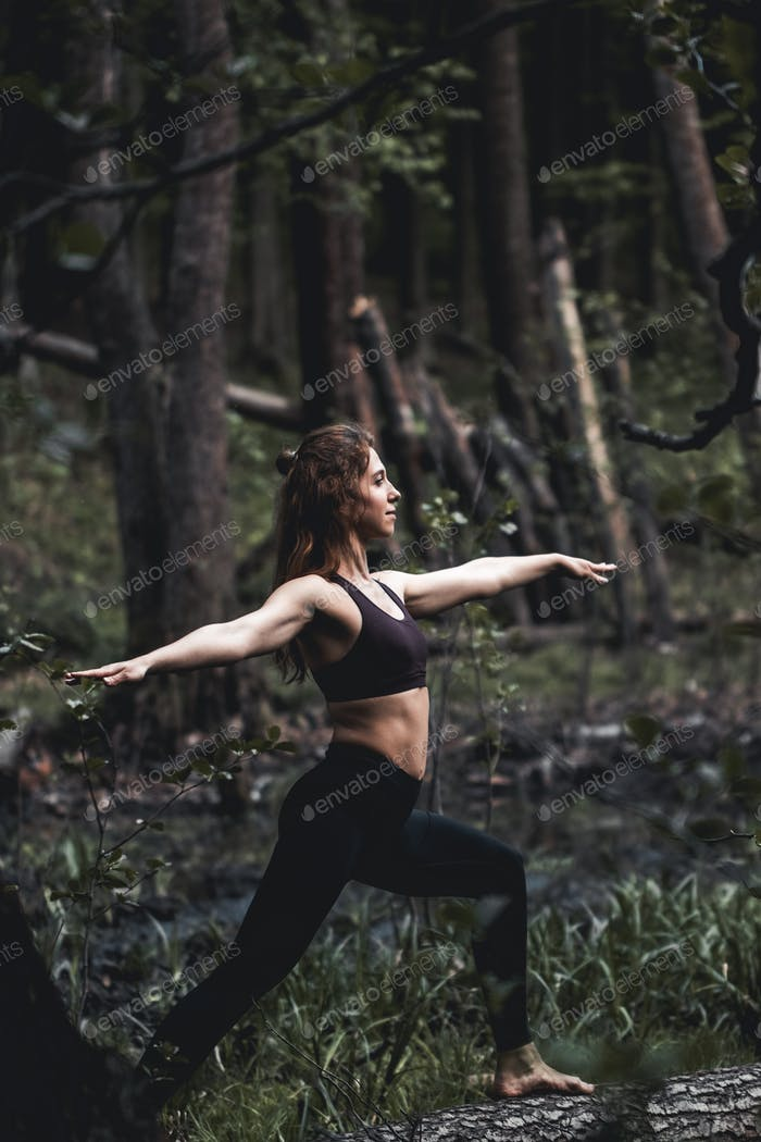Girl go in for sports in the forest. Exercises, gymnastics, relaxation. Healthy lifestyle
