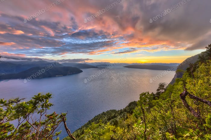 Sunset over fjord around Vestnes in Norway in HDR