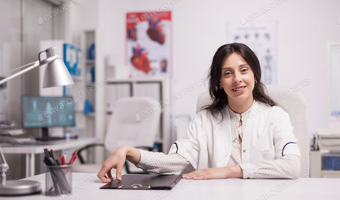 Cheerful attractive woman doctor