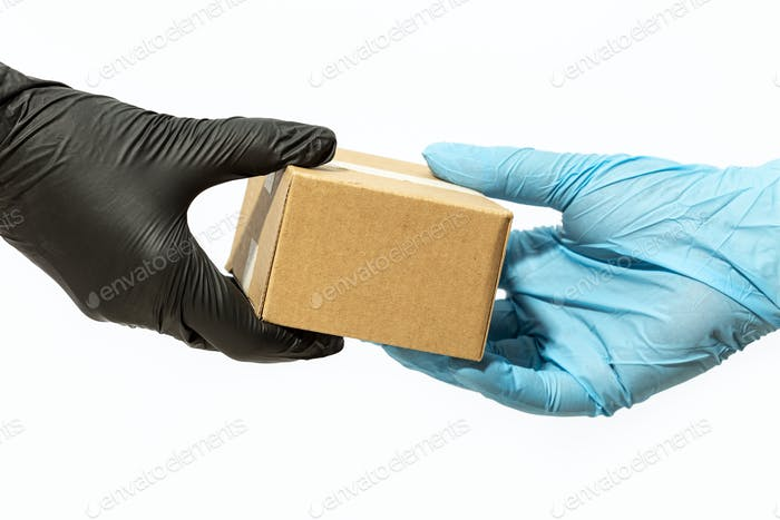Courier man hand in protective glove delivering a package to a customer or online buyer