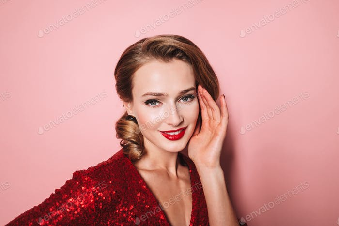 Close up young attractive smiling woman with wavy hairstyle and