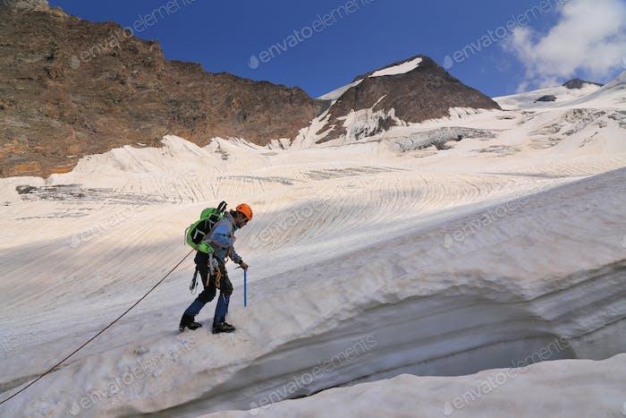 Climber the rising a high mountain