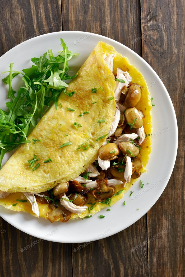 Omelet with mushrooms, chicken meat, greens