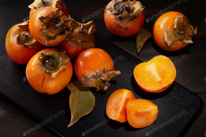 Persimmon still life in low key