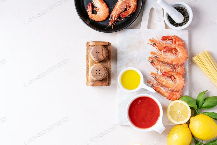 Raw ingredients for cooking: Shrimp prawns Italian spaghetti pasta