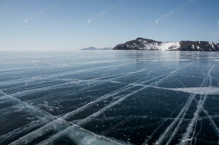 beautiful scenic landscape with frozen sea and mountains, Russia, Lake Baikal, march 2020