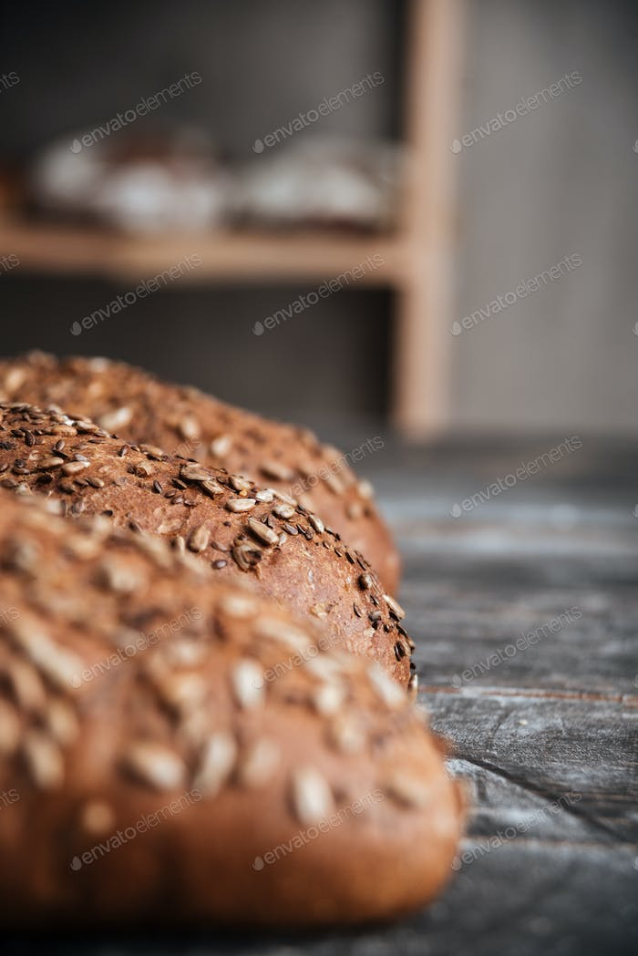 Bread on dark wooden table at bakery