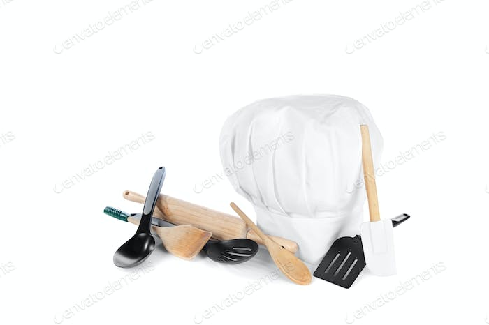 Chef's hat with cooking utensils