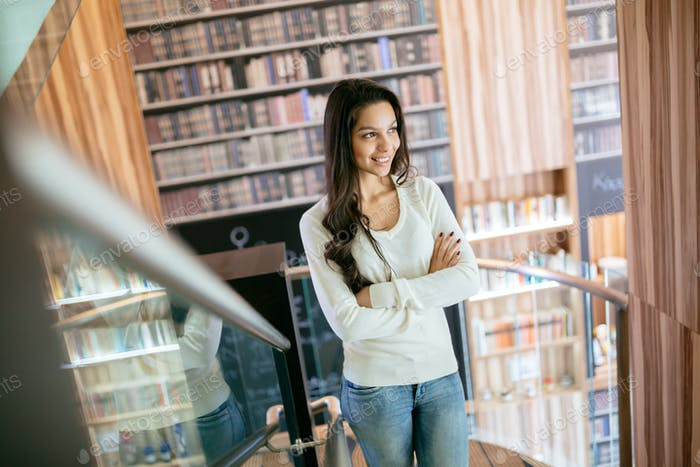 Beautiful brunette in library