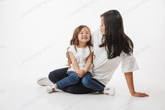 Cute young asian woman mother with her little daughter