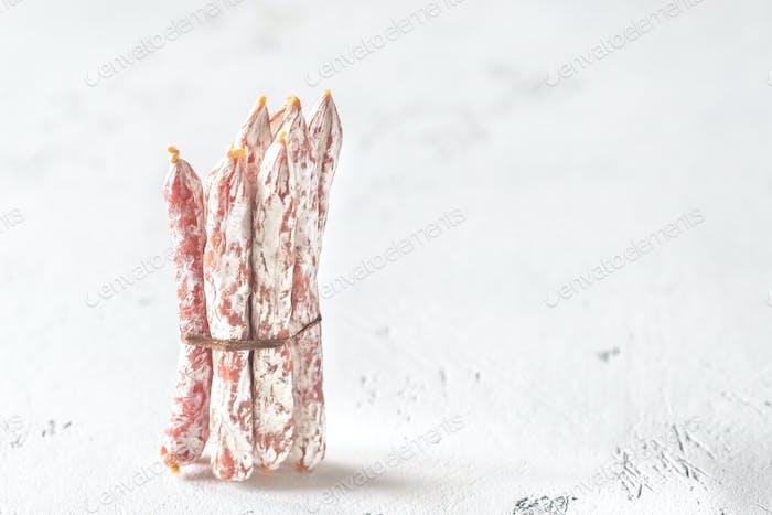 Snack fuet sausages close-up