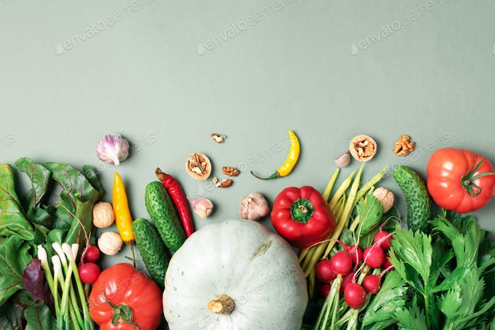 Vegan and vegetarian diet, harvest concept. Autumn vegetables on green background. Top view