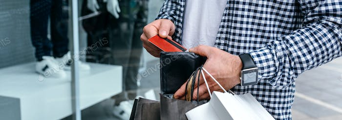 Man taking out credit card