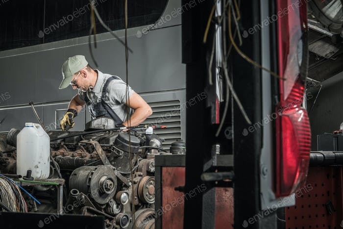 Automotive Technician Restoring Old Diesel Engine