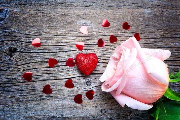 Valentines Day concept with red glitter hearts and pink roses