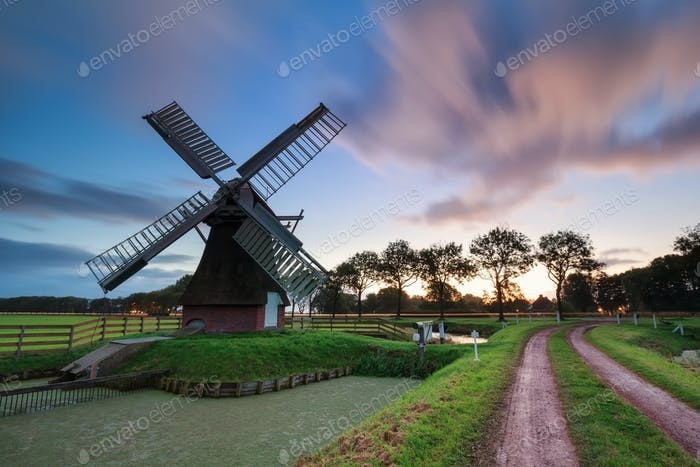 sunrise over Dutch windmill in summer