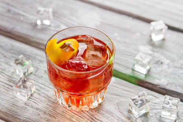 Glass with dark orange beverage