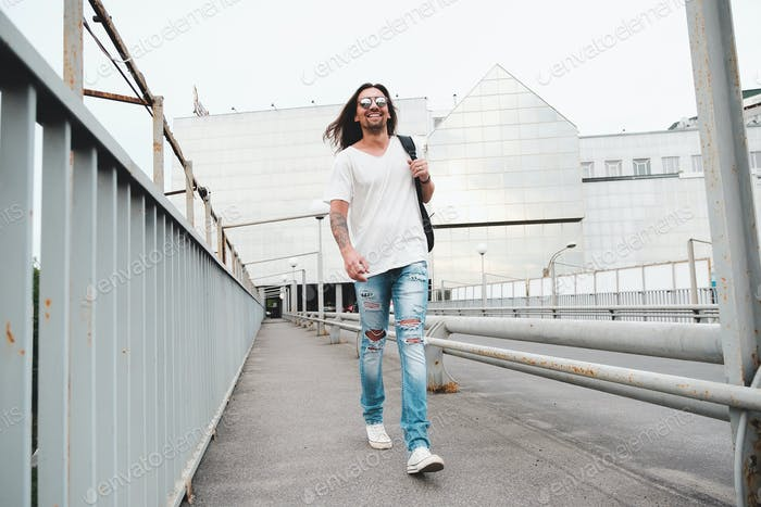 Happy man walking in the city