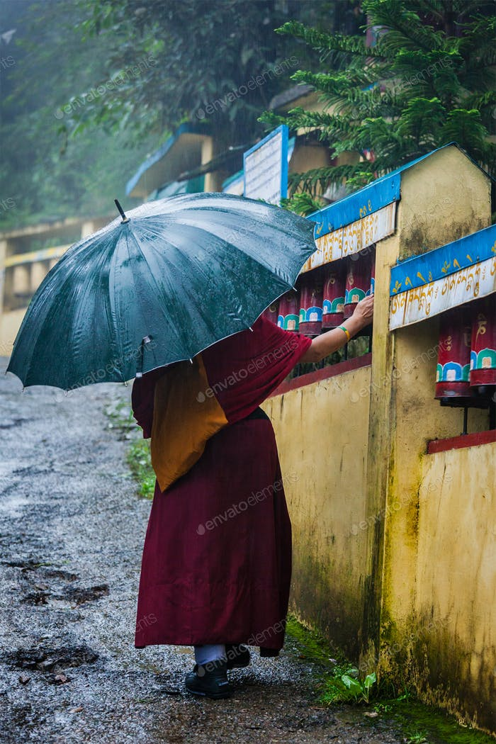 Buddhist monk with umbrella in McLeod Ganj
