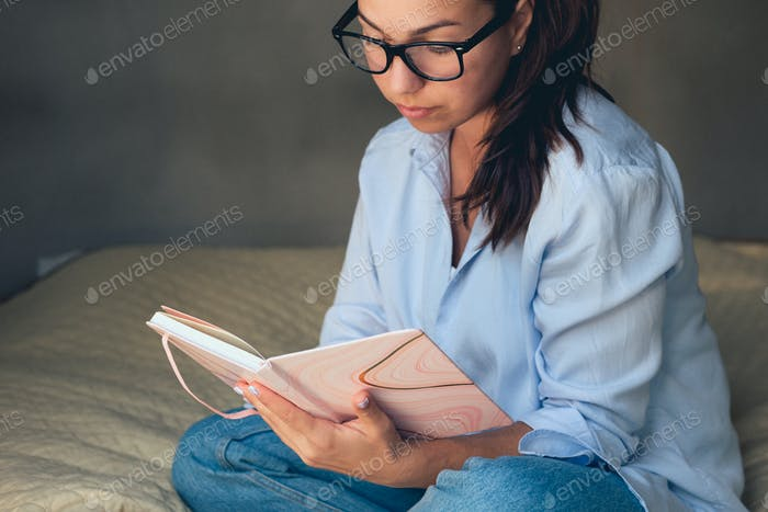 Relaxed happy woman reading a book