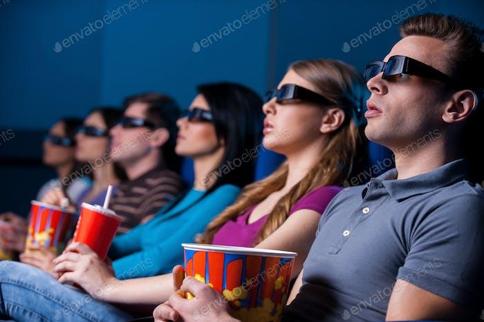 People enjoying three-dimensional movie.