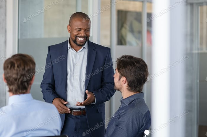 Mature business man in meeting smiling